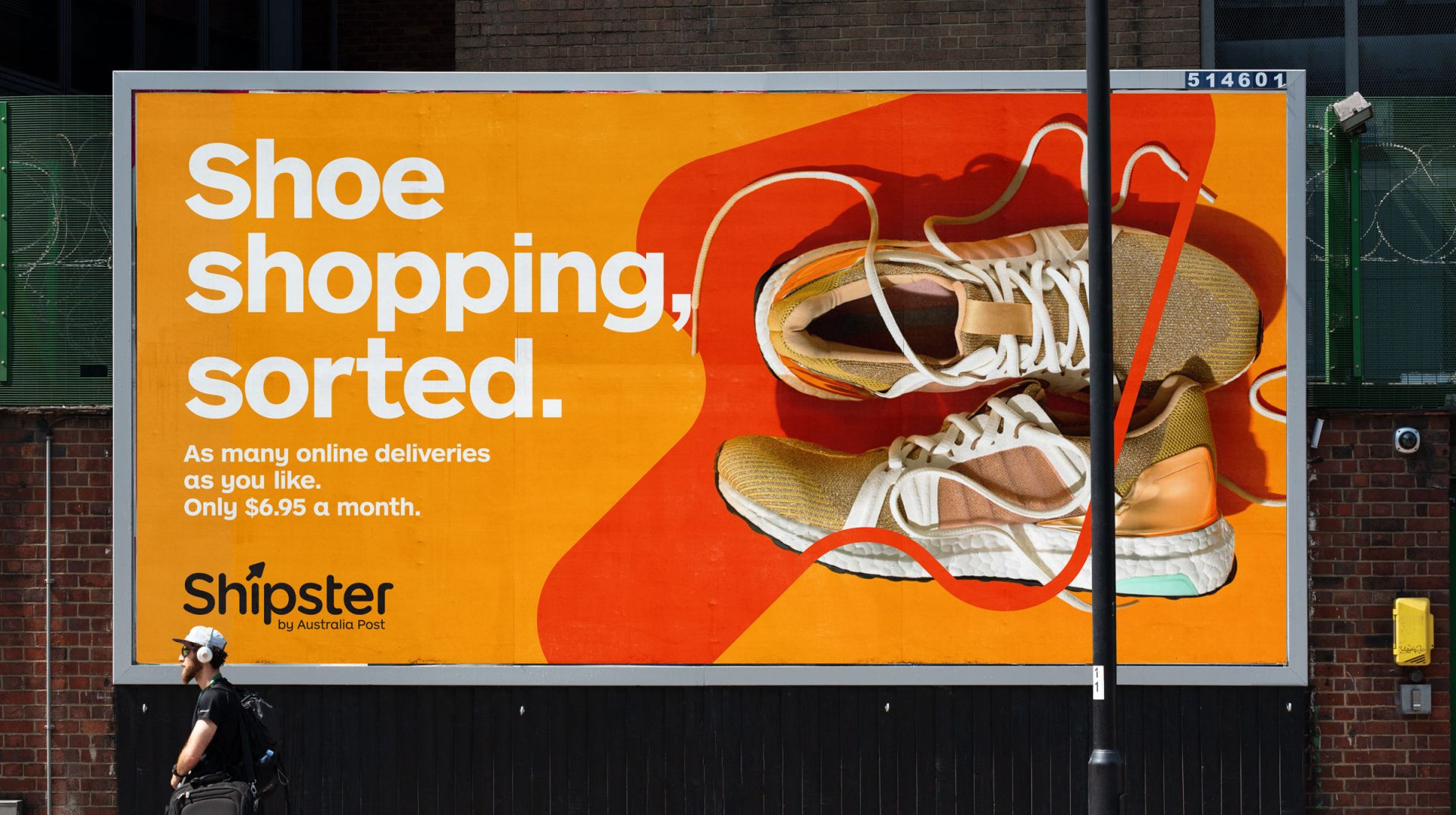 An orange billboard with sneakers over a large dark orange arrow, with the text 'Shoe shopping, sorted.'