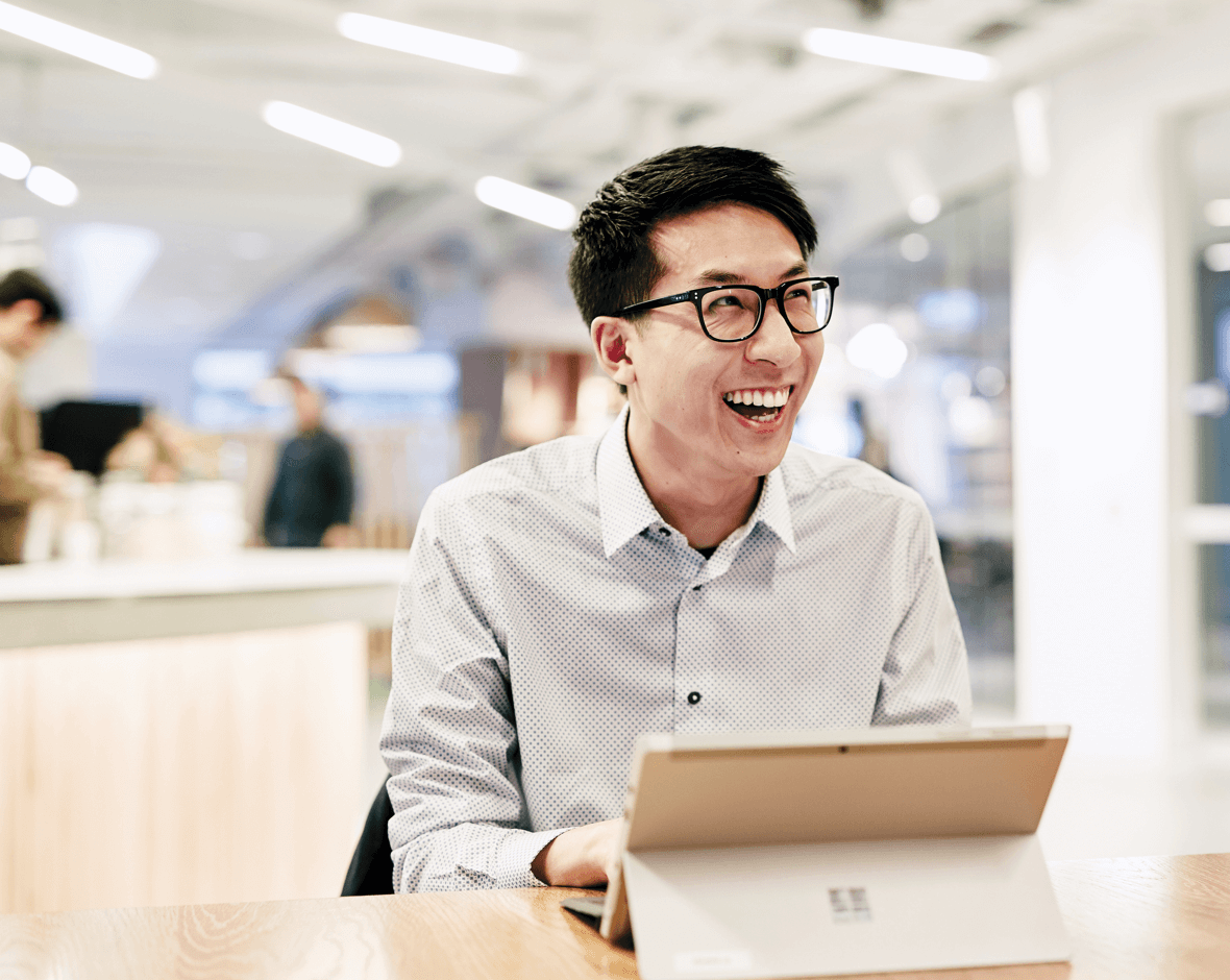 Image of a smiling man working in an Investa office