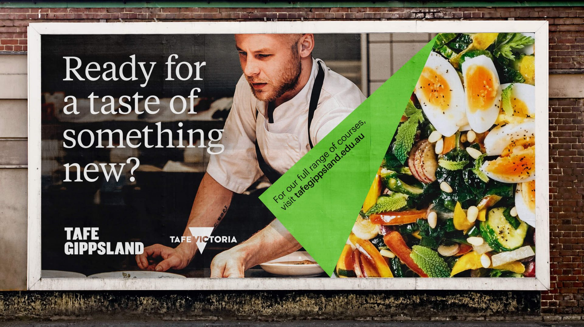 A billboard with an image of a chef on one side and a tasty salad on the other. It says 'Ready for a taste of something new'